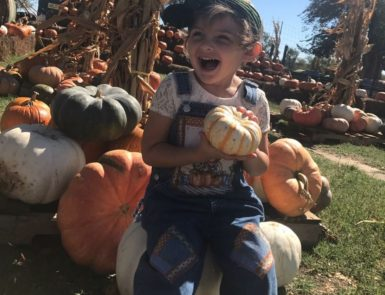 child at pumpkin patch kenny farms